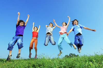 Group of five happy children jumping outdoors. | by Ronlavine