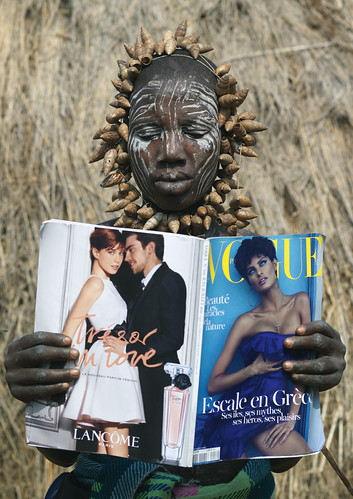 Mursi tribe Woman Reading Vogue Magazine - Omo Valley Ethiopia | by Eric Lafforgue