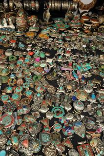 Tibetan style jewelry for sale, amulets, coral, turquoise, silver, white metal, Tibetan Buddhist symbols, Kalachakra for World Peace, Washington D.C., USA   by Wonderlane