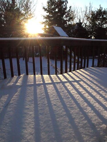 morning trees sun sunlight snow sunrise early backyard shadows deck railing