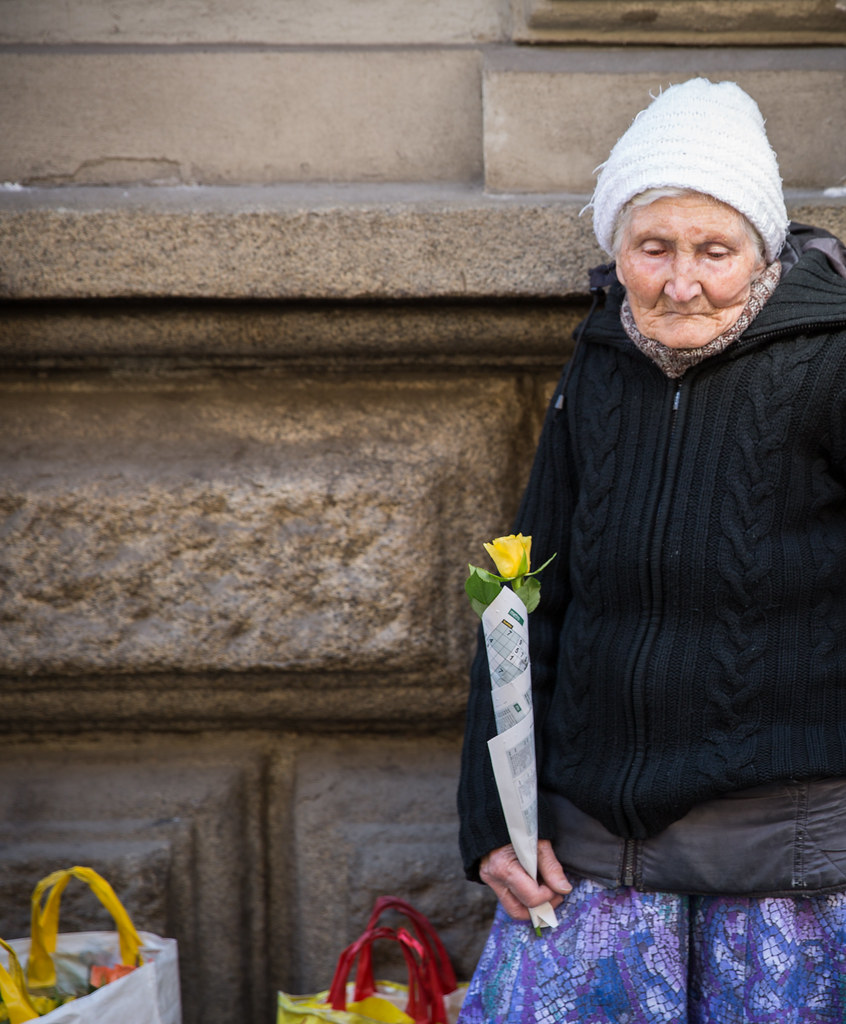 Old Homeless Woman with a Flower