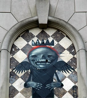 """Happy New Year! What we fear the most - Angel of Death, Angel of Change, signed """"ego"""", toothy, empty, grinning, skull, wearing black, hollow eye sockets, TUBS graffiti, U District, Seattle, Washington, USA 