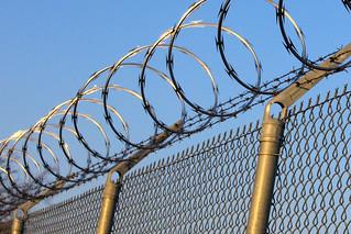 razor wire on fence - silent sentry | by woodleywonderworks