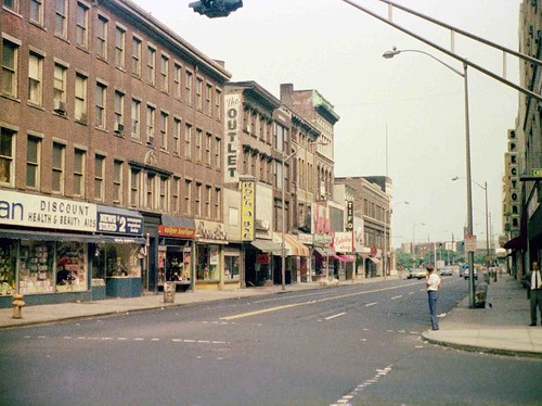 Stores on Chapel Street: Whelan Drugs, News Stand 2, Unique Boutique, The Outlet, Rock A Bye, Tiffon Jewelers, Exclusive Shop, Grants, Spectors, Lerners (and a guy all the way to the right watching me take this photo). New Haven Connecticut. July 1974 | by wavz13