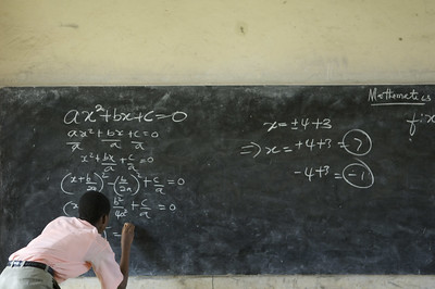 A student solves a mathematics equation at the Mfantsipim Boys School in Cape Coast