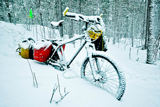 Snow coated bike | by tomsbiketrip.com