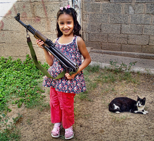 Daughter of my friend with a Machine Gun