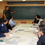Navy officer meets with Japanese officials to offer salvage/harbor clearing support.