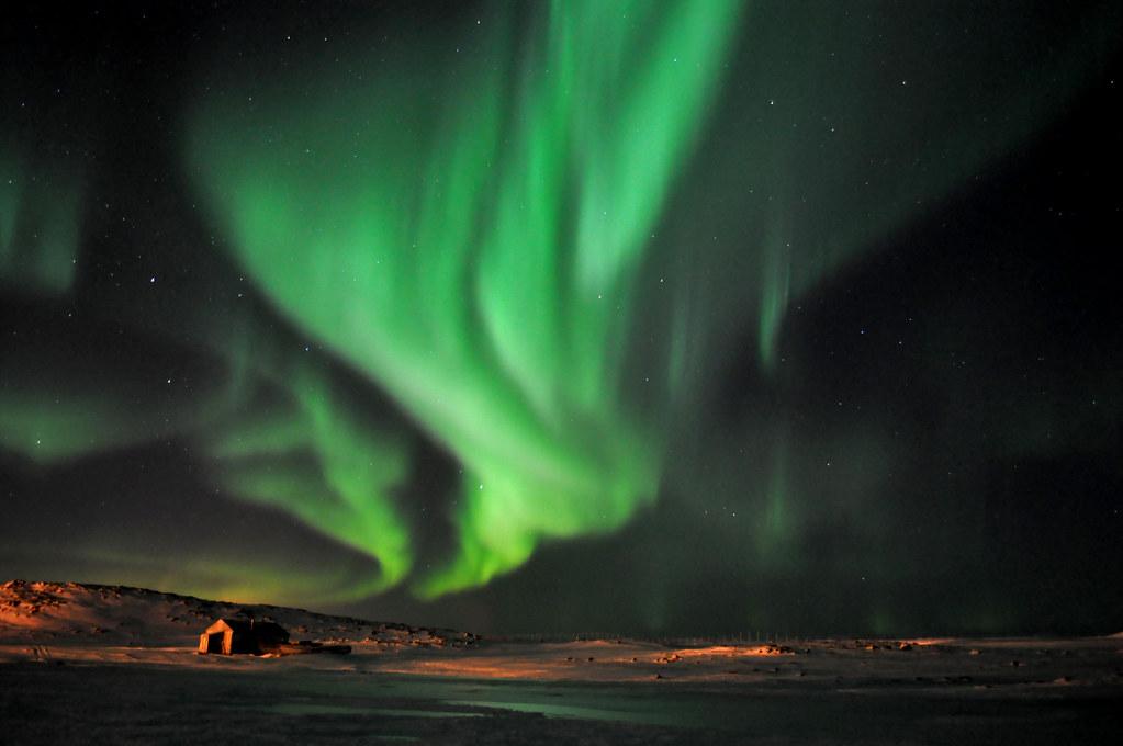 Northern lights over the Northern village of Quaqtaq, Québec, Canada
