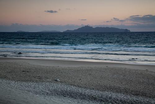newzealand sun beach water sunrise northland whangarei nzl mangawhaiheads breambay henandchickenislands tarangaisland moratereislands