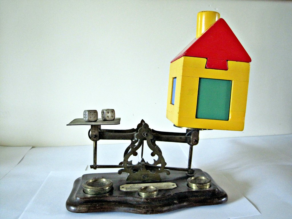 Dice and House on Weighing Scales
