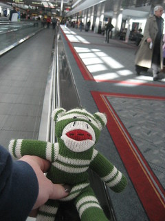 Sock Monkey rides the moving walkway | by TheKarenD