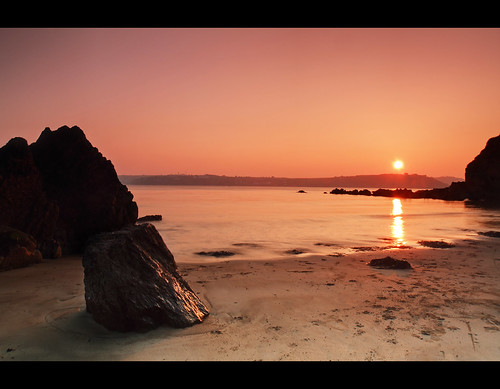 ocean pink ireland sunset red sea sun seascape landscape rocks waves cork whitebay trabolgan
