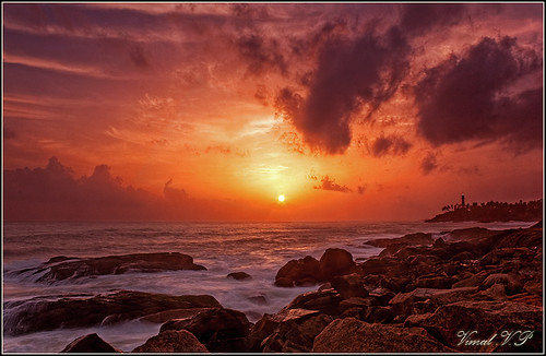 longexposure sunset sky cloud sun lighthouse india water rock canon kerala hdr trivandrum kovalam 500d vimal ndfilter vizhinjam beacch 1855is rebelt1i vimalvp