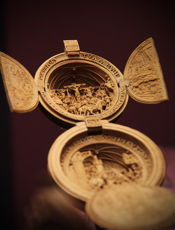 Boxwood rosary bead carved with sacred subjects and inscriptions, Flemish, early 1500s