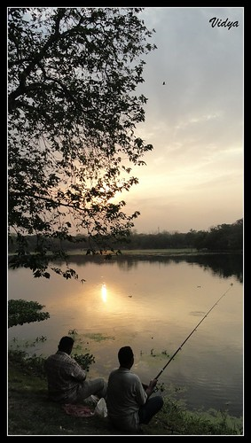 two lake fish reflection men water silhouette golden evening jubilee calm catch serene bags jamshedpur anglers
