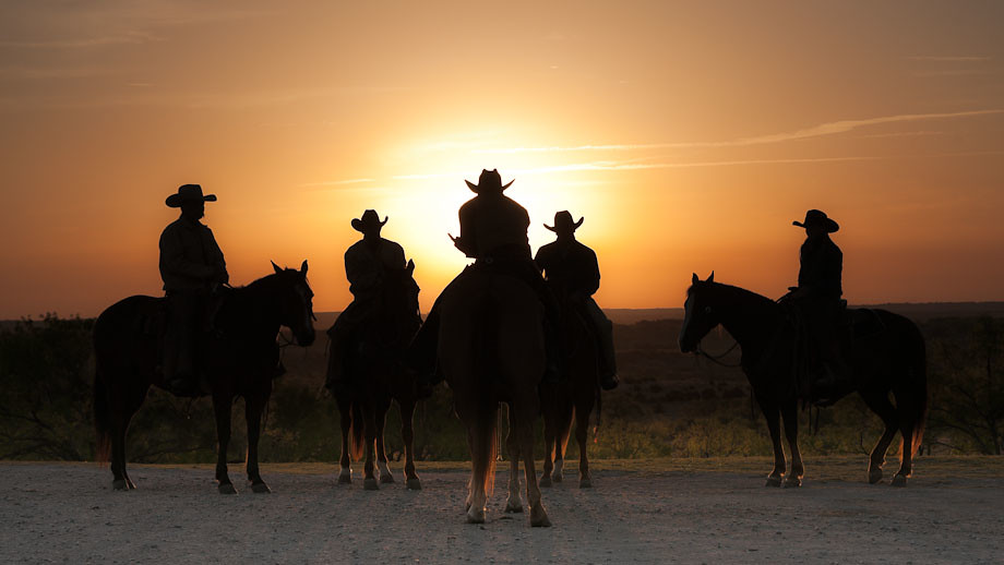 Cowboys and a Cowgirl at Sunrise