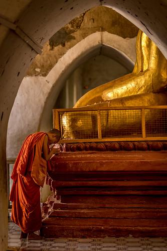Buddhist monk praying inside a pagoda, Bagan. | by tehhanlin