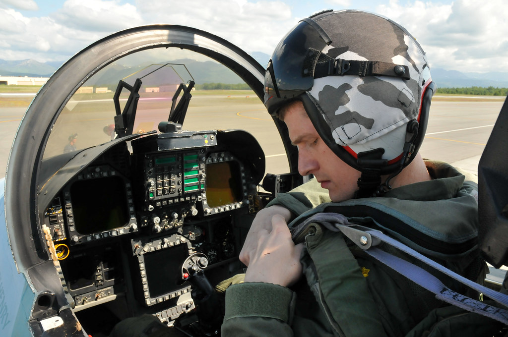 navy pilot secures his safety harness in the cockpit of an flickr rh flickr com