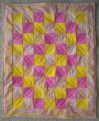 pink and yellow doll quilt