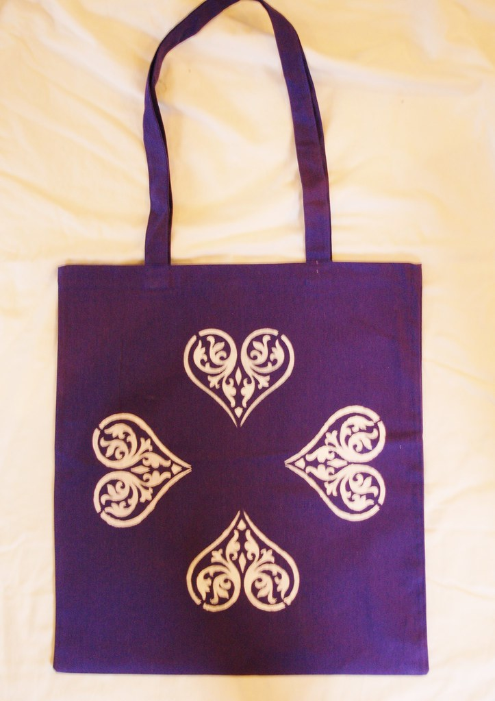 Tote bag in deep purple. Handstamped, white hearts. Machine washable. Great Valentine's Day present, also ideal for shopping, school, gym etc.  Size:  14.5in X 16.5.in Handle lenght: 26in