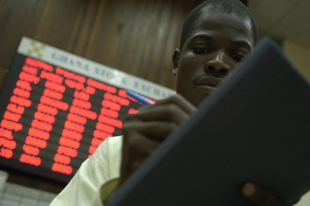 Traders work on the floor of the Ghana Stock Exchange