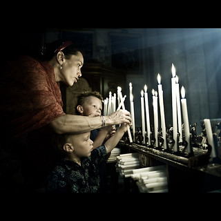 Lighting Candles   by PMMPhoto