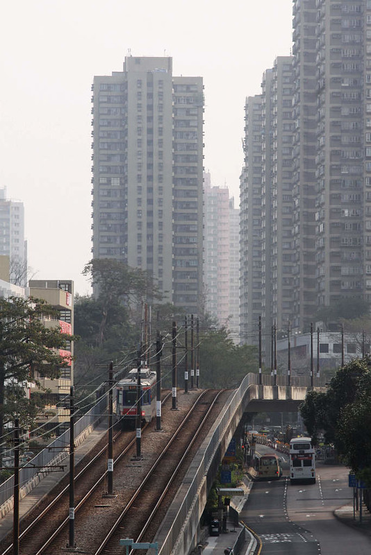 LRV climbs from Hoh Fuk Tong Stop onto the viaduct towards Tuen Mun station