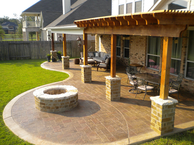 Patio Cover and cedar pergola with stamped concrete and fi ...