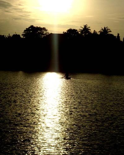 sunset sun lake canoe