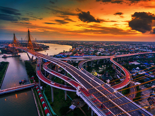 Road roundabout with car lots in Thailand.Bhumibol Bridge in Thailand. | by Aor Chantip