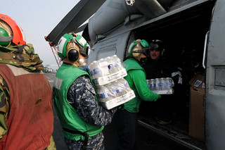 Sailors load Sea Hawk with water for humanitarian relief in Japan. | by Official U.S. Navy Imagery