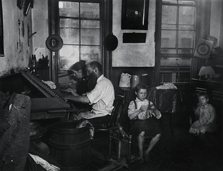 """Bohemian Cigarmakers at work in their Tenement"" 
