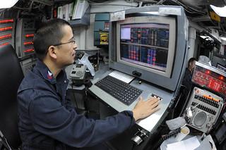 USS Ardent Sailor monitors the electronic propulsion plant console control station. | by Official U.S. Navy Imagery