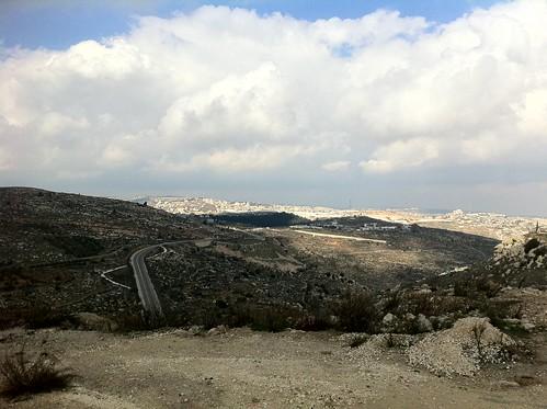 road cliff clouds rocks hills dirt