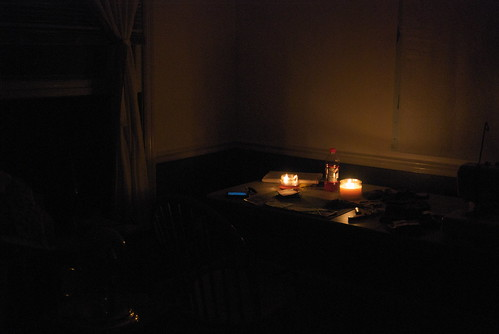 Where I've spent my powerless nights - candlelight in my new sewing room, cutting fabric.