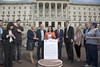 "15 September  2016 - Copyright © Kevin Cooper Photoline NUJ: Paula Bradley MLA Chair of the Health Committee, speaking at campaign ""More Dough Needed"" to the steps of Parliament Buildings on Thursday 15 September 2016 with Deputy Chair of the Health Committee, Paula Bradley MLA and Gary Middleton MLA with MLAs. Mental health rights campaigners from different parts of the north including Belfast, Derry, Draperstown and Cookstown took their campaign to the steps of Parliament Buildings on Thursday 15 September 2016, along with MLAs and mental health charities, to call on the Minister of Health Michelle O'Neill MLA to increase funding for mental health services, as part of their #MoreDoughNeeded campaign. The Mental Health Rights Campaign group gave an Open Letter to the Health Minister calling for funding of mental health services in line with need. While mental health accounts for approximately 25% of health cases it currently receives only 8.5% of the health budget. The open letter was also supported by many MLAs including the Chair and Deputy Chair of the Health Committee, Paula Bradley MLA and Gary Middleton MLA as well as the Chair of the All Party Group on Mental Health Mark H Durkan MLA, who all attendance the #MoreDoughNeeded event. Campaigners held Unfair Share Cake 3 foot cake, individual cup cakes and an A1 size copy of the open letter. Mental Health Rights Campaigners told the Health Minister 'more dough needed'."