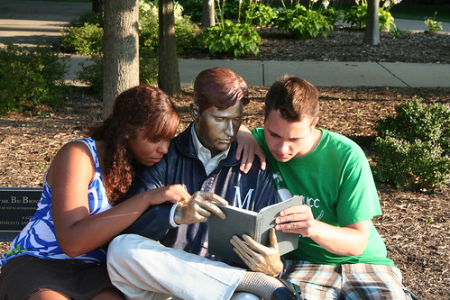 Students read along with Bronze Man