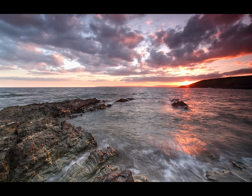 ocean pink ireland sunset red sea sun seascape landscape rocks waves hand cork rocky guileen