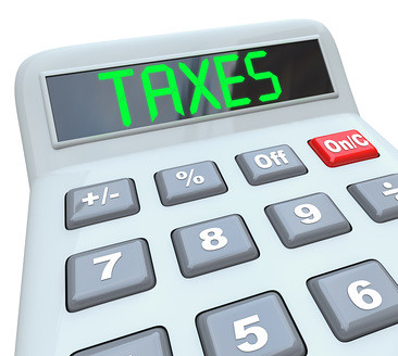 Taxes - Word on Calculator for Tax Accounting | A plastic ca