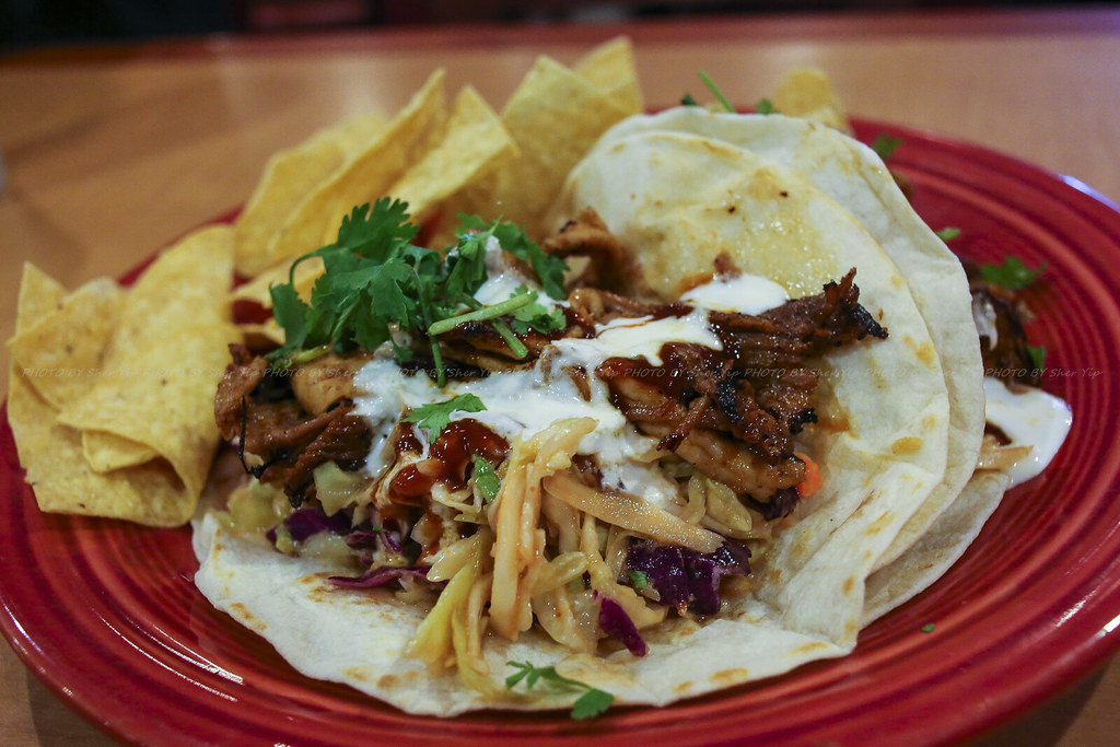 BBQ Pork Tacos - Slow roasted pork shoulder simmered in a