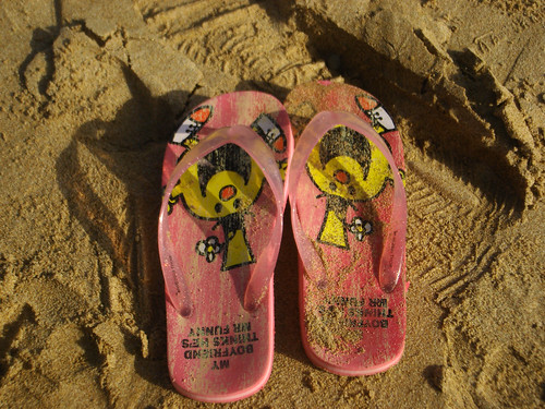 pink red orange sunlight beach sand flipflops editorial slippers allrightsreserved ©batoolnasir
