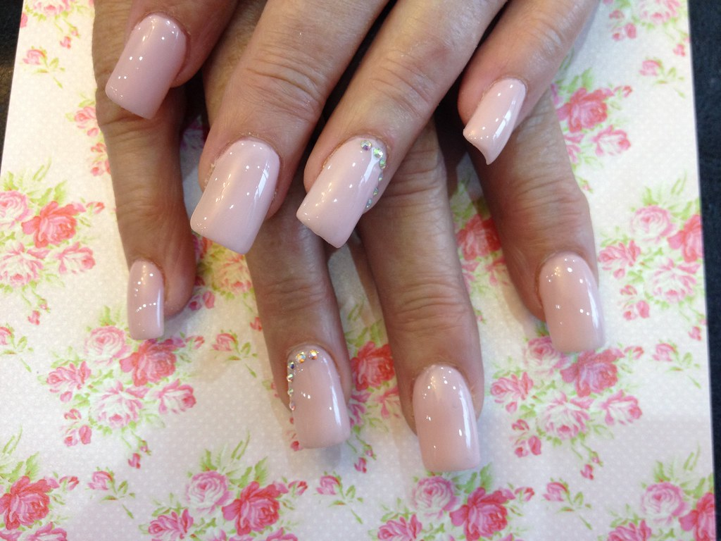 e248e8be8 ... Acrylic nails with pinky nude gel polish and Swarovski crystals on ring  finger | by Eye