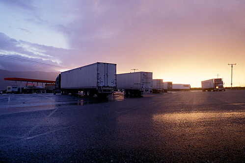 trucks sunset storm clouds cabazon desert california 2005 eyetwist ishootfilm ishootfuji contactforstockusage americana nikon n90s film emulsion analog analogue fujifilm fujichrome velvia rvp 50 chrome scansfromthearchives bigrig trucker trucking transport roadside truckstop stormclouds clearing 18wheeler freeway highway interstate dramatic america usa road roadtrip american west wheels