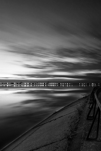 longexposure blackandwhite bw lake reflection bulb clouds sunrise canon citylights smoothwater lightsreflections