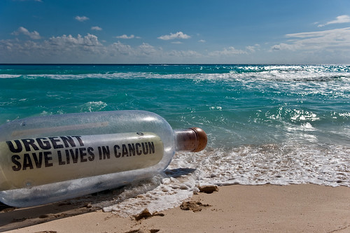 Message in a Bottle: Save Lives at Cancun | by Oxfam International