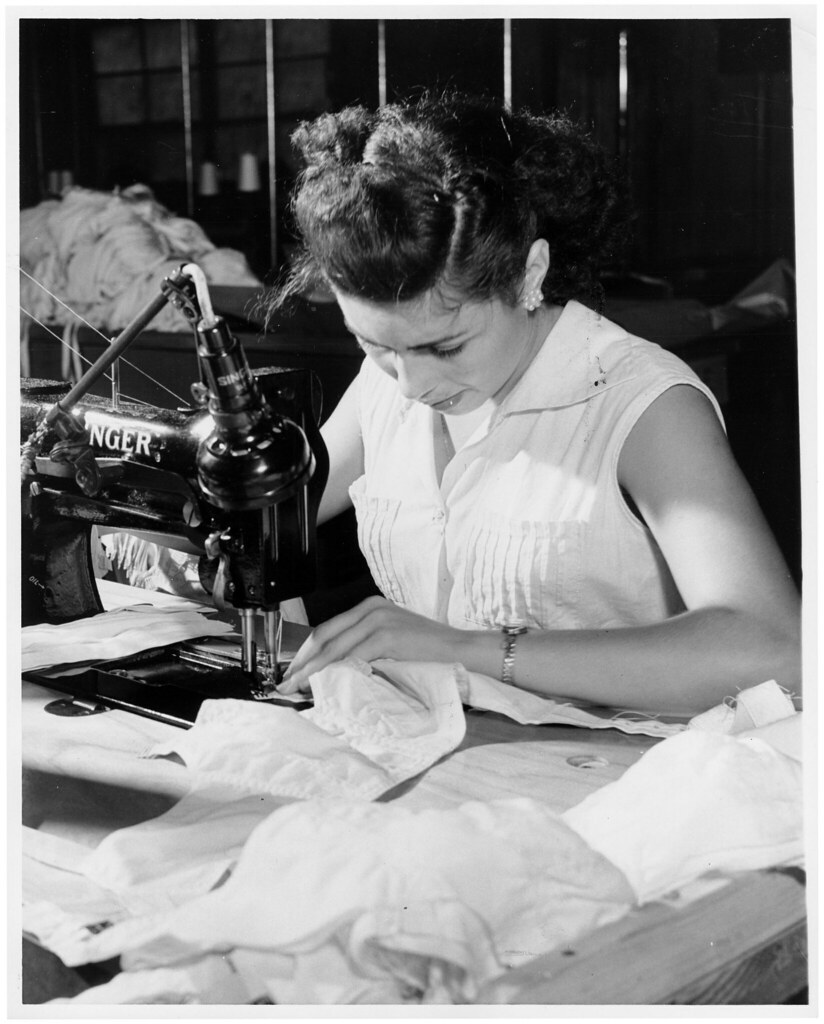 Woman Using A Sewing Machine In A Puerto Rico Garment Shop