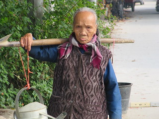 100 year old woman, Carrying 100 pounds   by everlutionary