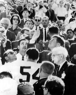 President John F. Kennedy Tossing Coin to Start the Orange Bowl: Miami, Florida