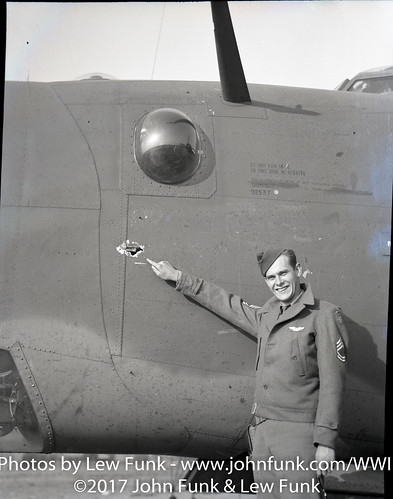 T/Sgt Shepherd G. Litsey points out Flak dammage on B-24H-16 Serial No. 42 94766. | by John Funk from Golden Colorado